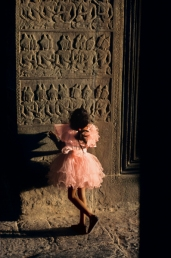 00056_04, Angkor Wat, Angkor, Cambodia, 1998, CAMBODIA-10111. A little girl looks at the carvings. Magnum Photos, NYC8848, MCS1998012 K041. Sanctuary: Temples of Angkor_Book Retouched_Ekaterina Savtsova 11/7/2013